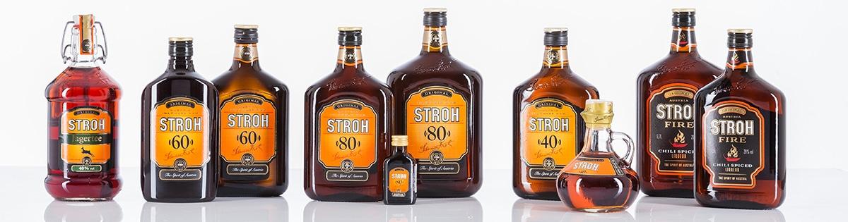 Verschillende Stroh-rum flessen